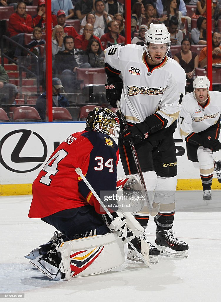 Goaltender Tim Thomas #34 of the Florida Panthers stops a tip-in attempt by <a gi-track='captionPersonalityLinkClicked' href=/galleries/search?phrase=Nick+Bonino&family=editorial&specificpeople=5805660 ng-click='$event.stopPropagation()'>Nick Bonino</a> #13 of the Anaheim Ducks at the BB&T Center on November 12, 2013 in Sunrise, Florida.