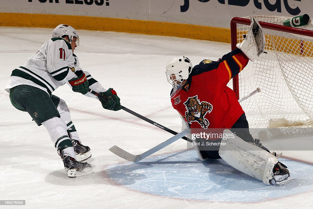 Goaltender Tim Thomas #34 of the Florida Panthers stops <a gi-track='captionPersonalityLinkClicked' href=/galleries/search?phrase=Zach+Parise&family=editorial&specificpeople=213606 ng-click='$event.stopPropagation()'>Zach Parise</a> #11 of the Minnesota Wild in a shoot-out at the BB&T Center on October 19, 2013 in Sunrise, Florida.