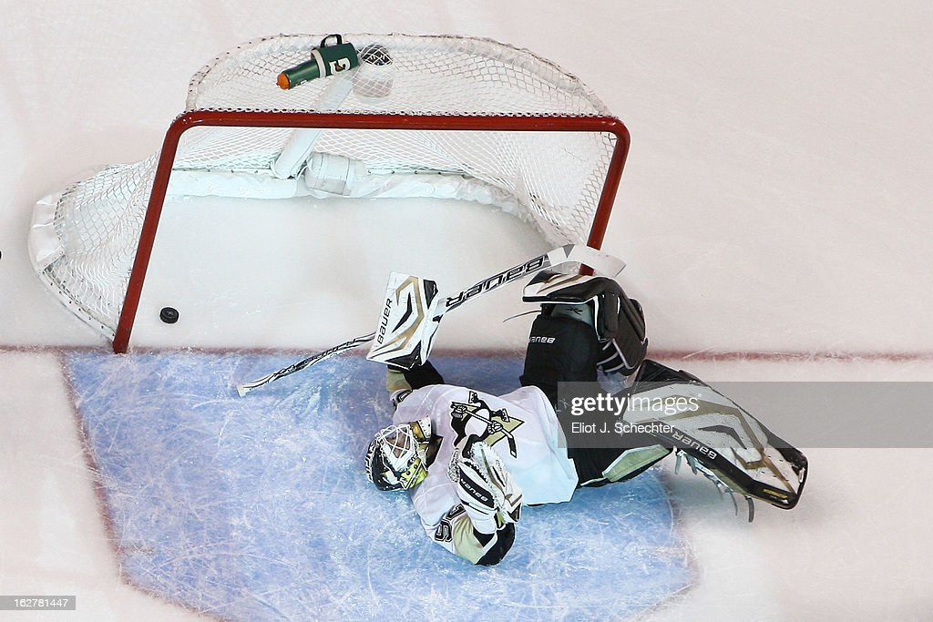 Goaltender <a gi-track='captionPersonalityLinkClicked' href=/galleries/search?phrase=Tomas+Vokoun&family=editorial&specificpeople=202179 ng-click='$event.stopPropagation()'>Tomas Vokoun</a> #92 of the Pittsburg Penguins lying on the ice motionless after a goal scored by <a gi-track='captionPersonalityLinkClicked' href=/galleries/search?phrase=Marcel+Goc&family=editorial&specificpeople=541626 ng-click='$event.stopPropagation()'>Marcel Goc</a> #57 of the Florida Panthers at the BB&T Center on February 26, 2013 in Sunrise, Florida.