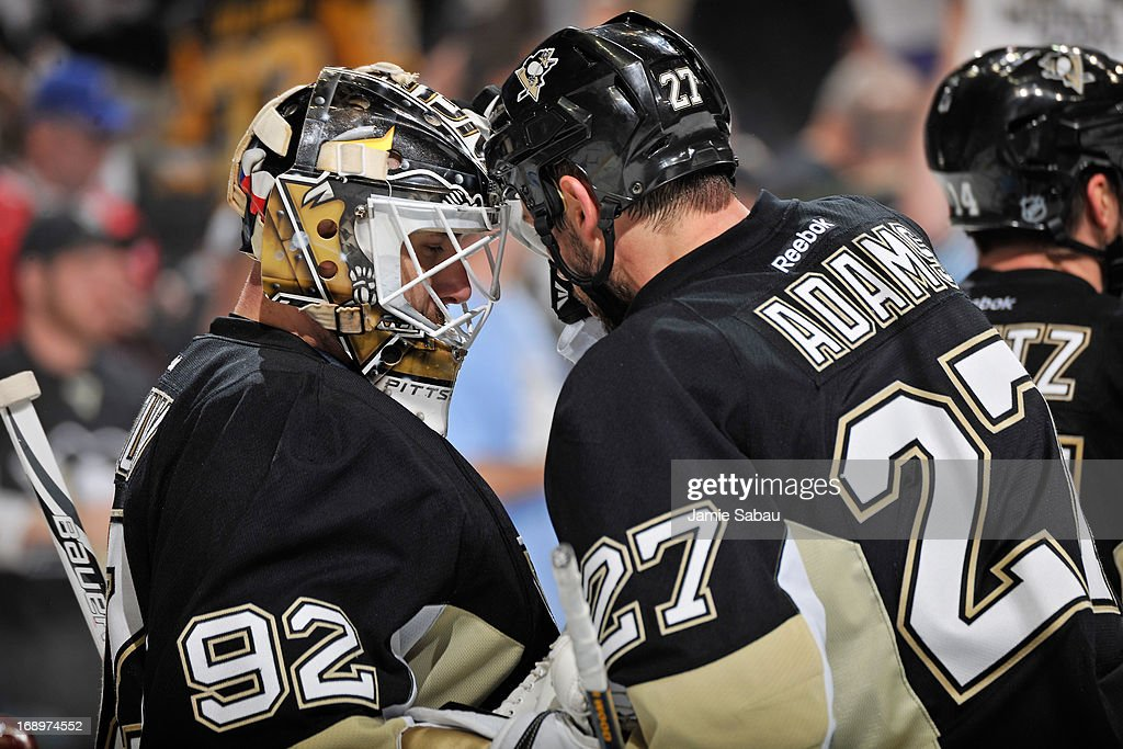 Goaltender <a gi-track='captionPersonalityLinkClicked' href=/galleries/search?phrase=Tomas+Vokoun&family=editorial&specificpeople=202179 ng-click='$event.stopPropagation()'>Tomas Vokoun</a> #92 of the Pittsburgh Penguins and <a gi-track='captionPersonalityLinkClicked' href=/galleries/search?phrase=Craig+Adams&family=editorial&specificpeople=211144 ng-click='$event.stopPropagation()'>Craig Adams</a> #27 of the Pittsburgh Penguins celebrate a 4-3 win over the Ottawa Senators in Game Two of the Eastern Conference Semifinals of the 2013 Stanley Cup Playoffs on May 17, 2013 at CONSOL Energy Center in Pittsburgh, Pennsylvania.