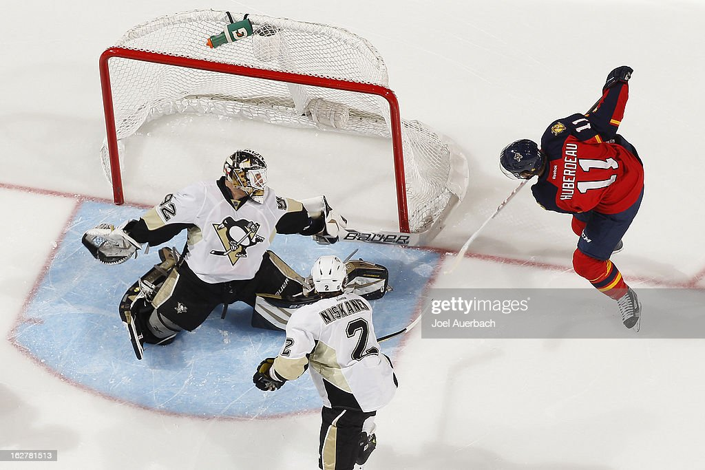 Goaltender <a gi-track='captionPersonalityLinkClicked' href=/galleries/search?phrase=Tomas+Vokoun&family=editorial&specificpeople=202179 ng-click='$event.stopPropagation()'>Tomas Vokoun</a> #92 of the Pittsburgh Penguins stops a shot by <a gi-track='captionPersonalityLinkClicked' href=/galleries/search?phrase=Jonathan+Huberdeau&family=editorial&specificpeople=7144196 ng-click='$event.stopPropagation()'>Jonathan Huberdeau</a> #11 of the Florida Panthers during second period action at the BB&T Center on February 26, 2013 in Sunrise, Florida. The Panthers defeated the Penguins 6-4.