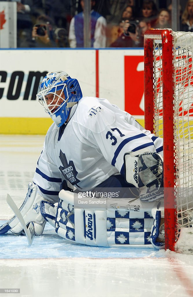 Goaltender Trevor Kidd #37 of the Toronto Maple Leafs goes down to make a save against the Ottawa Senators during the game on October 12, 2002 at Air Canada Centre in Toronto, Ontario, Canada.