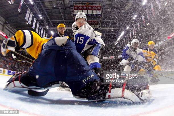 Goaltender Troy Timpano of the Erie Otters makes a pad save on a shot from Matthew Highmore of the Saint John Sea Dogs on May 26 2017 during the...