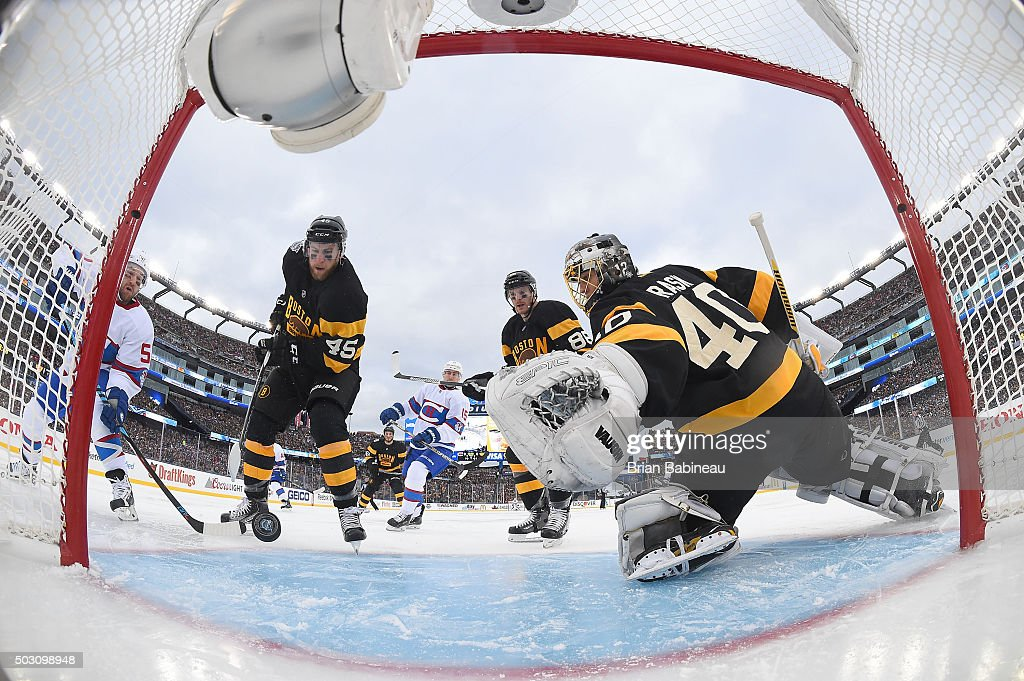 Goaltender Tuukka Rask and Joe Morrow of the Boston Bruins and David Desharnais of the Montreal Canadiens watch the loose puck to the left of the net...