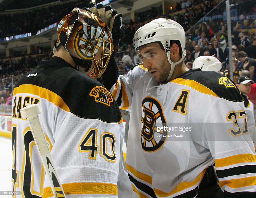 Goaltender Tuukka Rask #40 and Patrice Bergeron #37 of the Boston Bruins celebrate a 3-2 victory over the Winnipeg Jets at the MTS Centre on February 17, 2013 in Winnipeg, Manitoba, Canada.