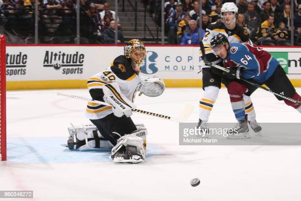 Goaltender Tuukka Rask and Torey Krug of the Boston Bruins watch the puck alongside Nail Yakupov of the Colorado Avalanche at the Pepsi Center on...