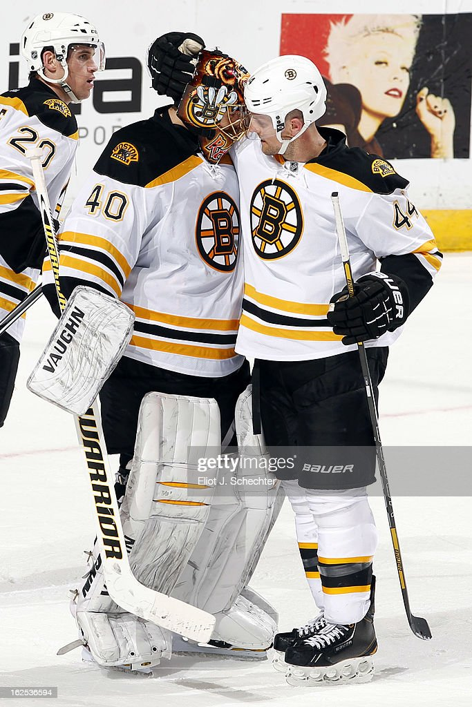 Goaltender Tuukka Rask #40 of the Boston Bruins celebrates with teammate Dennis Seidenberg #44 after their 4-1 win against the Florida Panthers at the BB&T Center on February 24, 2013 in Sunrise, Florida.