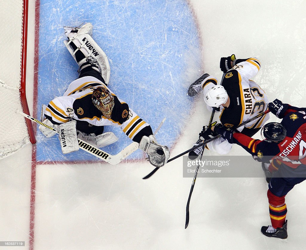 Goaltender <a gi-track='captionPersonalityLinkClicked' href=/galleries/search?phrase=Tuukka+Rask&family=editorial&specificpeople=716723 ng-click='$event.stopPropagation()'>Tuukka Rask</a> #40 of the Boston Bruins defends the net with the help of teammate Zdeno Chara #33 against <a gi-track='captionPersonalityLinkClicked' href=/galleries/search?phrase=Tomas+Fleischmann&family=editorial&specificpeople=554398 ng-click='$event.stopPropagation()'>Tomas Fleischmann</a> #14 of the Florida Panthers at the BB&T Center on February 24, 2013 in Sunrise, Florida.