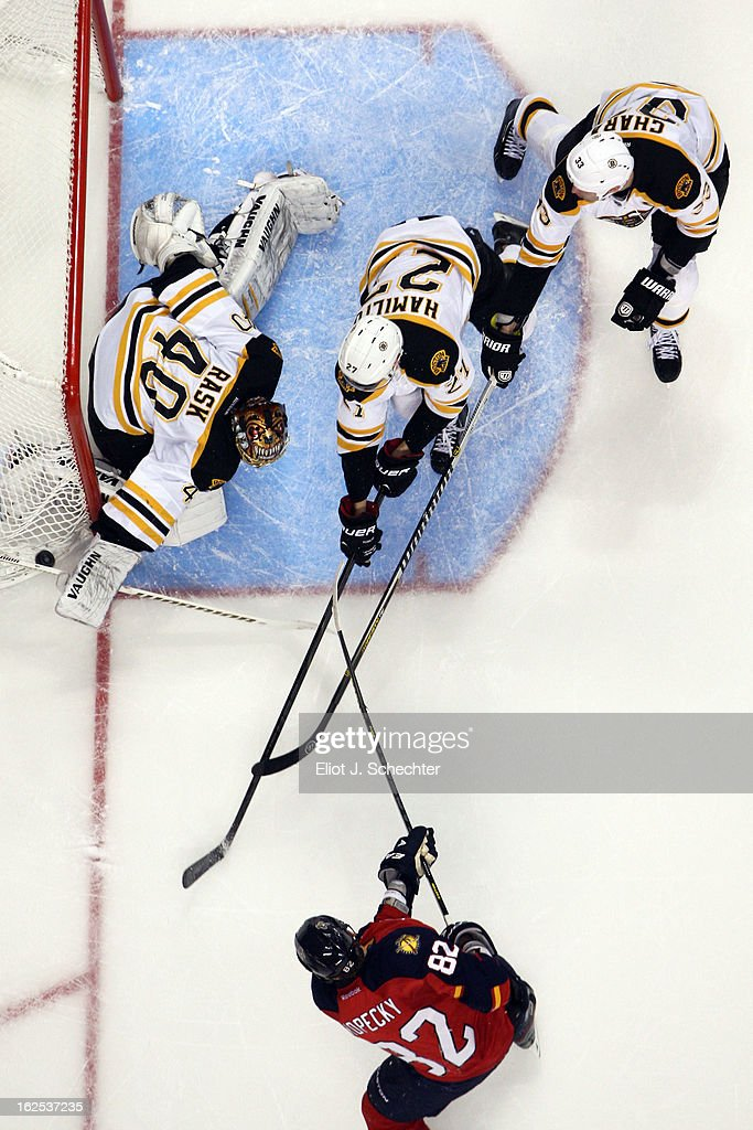 Goaltender <a gi-track='captionPersonalityLinkClicked' href=/galleries/search?phrase=Tuukka+Rask&family=editorial&specificpeople=716723 ng-click='$event.stopPropagation()'>Tuukka Rask</a> #40 of the Boston Bruins defends the net with the help of teammates Dougie Hamilton #27 and <a gi-track='captionPersonalityLinkClicked' href=/galleries/search?phrase=Zdeno+Chara&family=editorial&specificpeople=203177 ng-click='$event.stopPropagation()'>Zdeno Chara</a> #33 against <a gi-track='captionPersonalityLinkClicked' href=/galleries/search?phrase=Tomas+Kopecky&family=editorial&specificpeople=2234349 ng-click='$event.stopPropagation()'>Tomas Kopecky</a> #82 of the Florida Panthers at the BB&T Center on February 24, 2013 in Sunrise, Florida.
