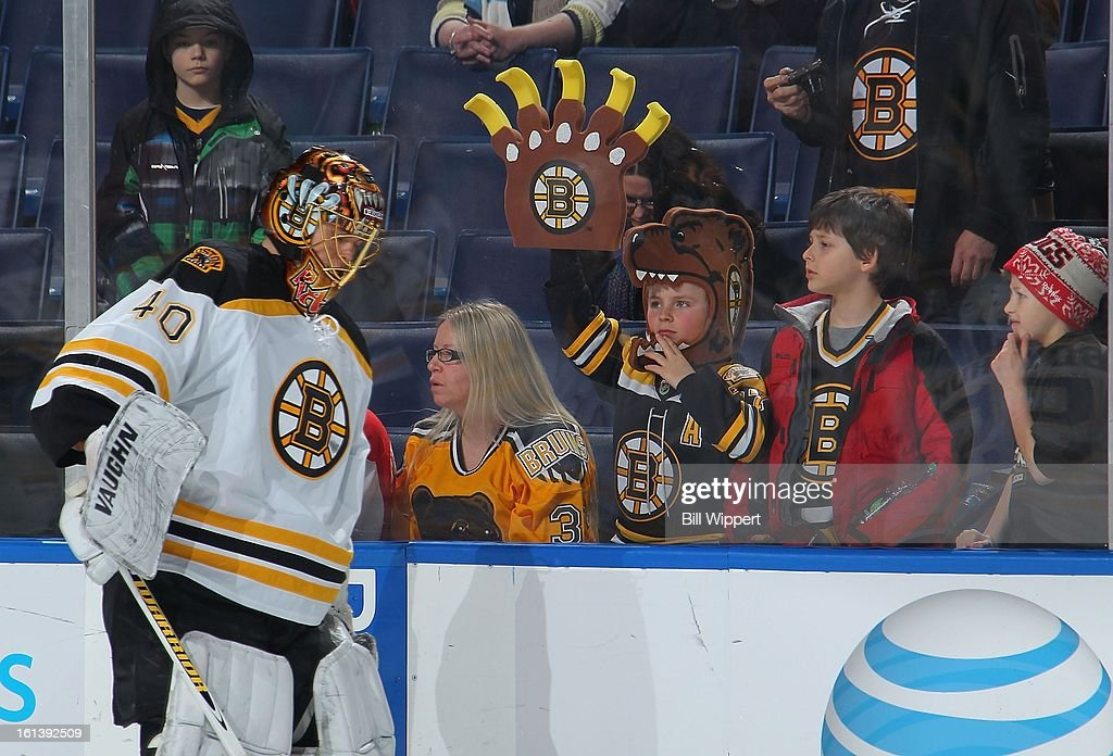 Goaltender Tuukka Rask #40 of the Boston Bruins draws the attention of front row fans while warming up to play the Buffalo Sabres on February 10, 2013 at the First Niagara Center in Buffalo, New York.