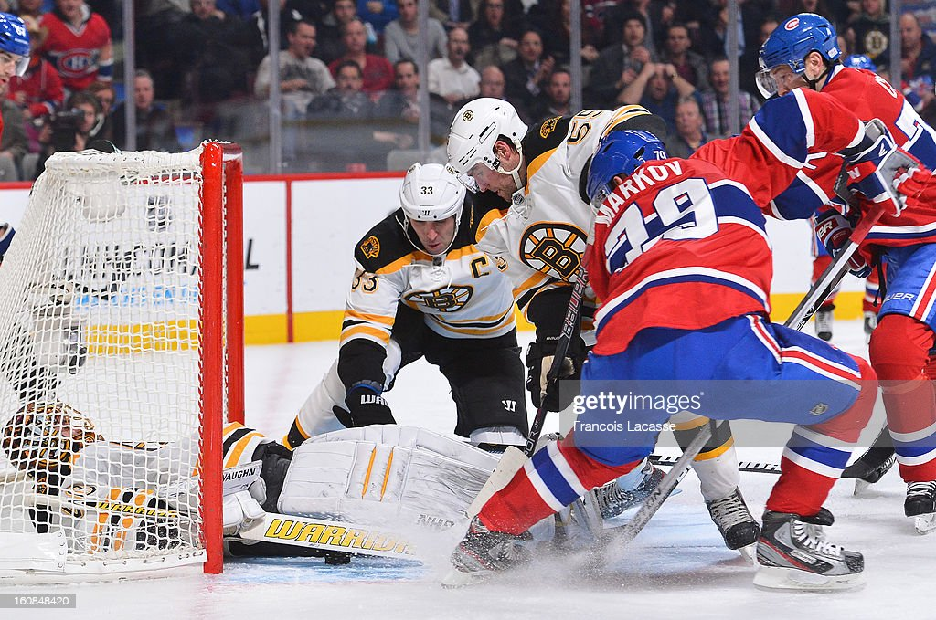Goaltender <a gi-track='captionPersonalityLinkClicked' href=/galleries/search?phrase=Tuukka+Rask&family=editorial&specificpeople=716723 ng-click='$event.stopPropagation()'>Tuukka Rask</a> #40 of the Boston Bruins falls on the puck during an NHL game against the Montreal Canadiens on February 6, 2013 at the Bell Centre in Montreal, Quebec, Canada.