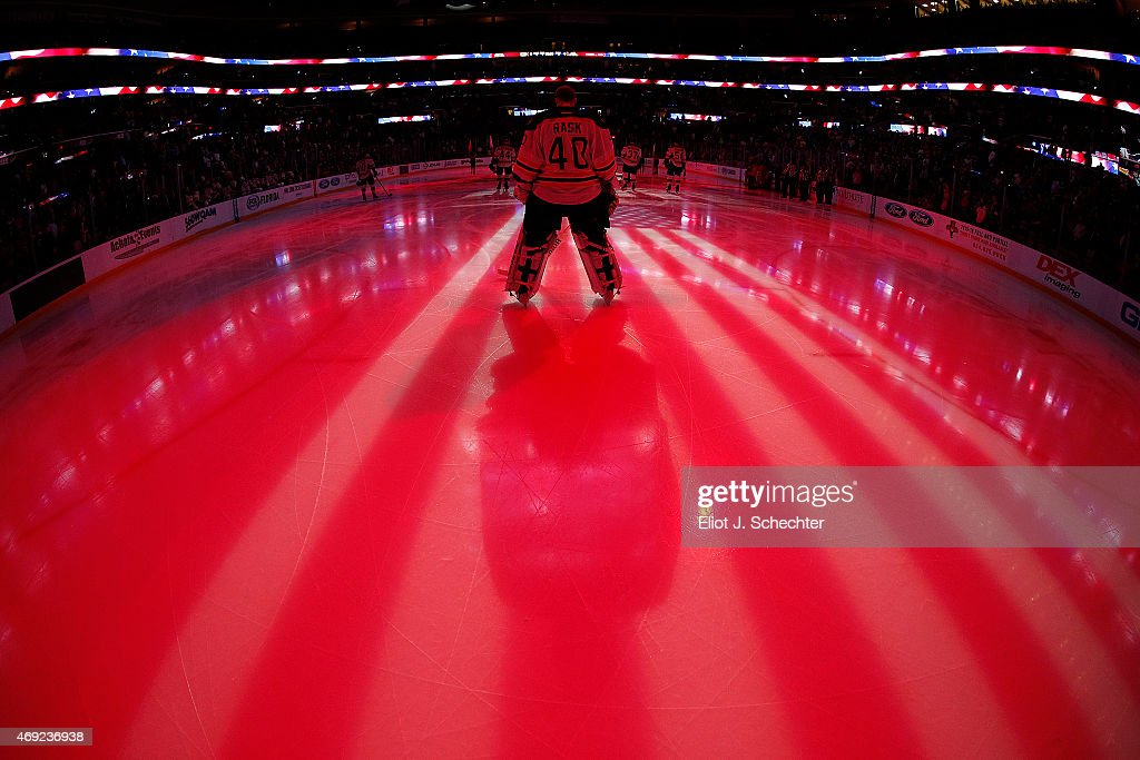 Goaltender Tuukka Rask of the Boston Bruins stands on the ice for the national anthem prior to to start of the game against the Boston Bruins at the...