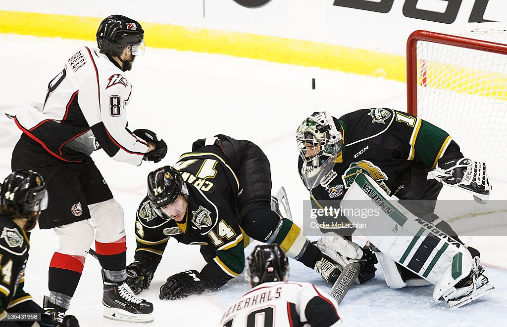 Goaltender Tyler Parsons #1 of the London Knights (OHL) stops Anthony-John Greer #8 of the Rouyn-Noranda Huskies (QMJHL) during the Memorial Cup Final on May 29, 2016 at the Enmax Centrium in Red Deer, Alberta, Canada.