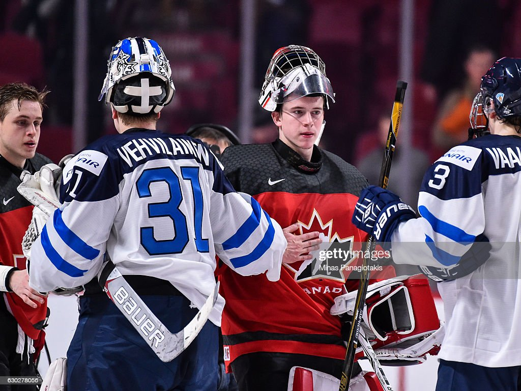 Goaltender Veini Vehvilainen of Team Finland #31 congratulates goaltender Carter Hart #31 of Team Canada during the IIHF exhibition game at the Bell Centre on December 19, 2016 in Montreal, Quebec, Canada. Team Canada defeated Team Finland 5-0.
