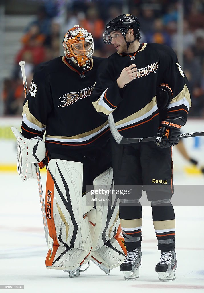 Goaltender Viktor Fasth #30 and Bobby Ryan #9 of the Anaheim Ducks talk during a stopage of play against the Minnesota Wild in the second period at Honda Center on February 1, 2013 in Anaheim, California. The Ducks defeated the Wild 3-1.