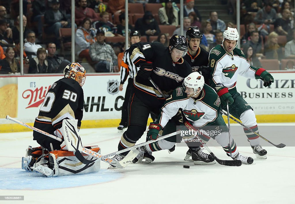 Goaltender Viktor Fasth #30 of the Anaheim Ducks defends, as <a gi-track='captionPersonalityLinkClicked' href=/galleries/search?phrase=Cam+Fowler&family=editorial&specificpeople=5484080 ng-click='$event.stopPropagation()'>Cam Fowler</a> #4 of the Ducks, <a gi-track='captionPersonalityLinkClicked' href=/galleries/search?phrase=Torrey+Mitchell&family=editorial&specificpeople=4504539 ng-click='$event.stopPropagation()'>Torrey Mitchell</a> #17 of the Wild, <a gi-track='captionPersonalityLinkClicked' href=/galleries/search?phrase=Bryan+Allen+-+Ice+Hockey+Player&family=editorial&specificpeople=206454 ng-click='$event.stopPropagation()'>Bryan Allen</a> #55 of the Ducks and <a gi-track='captionPersonalityLinkClicked' href=/galleries/search?phrase=Zenon+Konopka&family=editorial&specificpeople=2105876 ng-click='$event.stopPropagation()'>Zenon Konopka</a> #28 of the Wild pursue the puck in the third period at Honda Center on February 1, 2013 in Anaheim, California. The Ducks defeated the Wild 3-1.