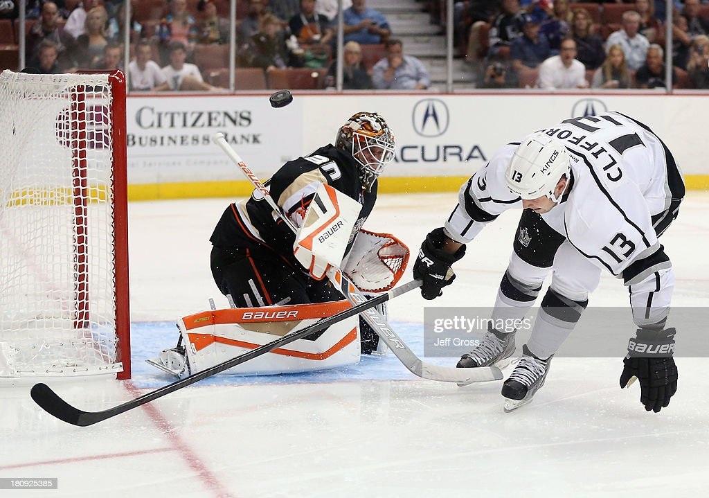 Goaltender <a gi-track='captionPersonalityLinkClicked' href=/galleries/search?phrase=Viktor+Fasth&family=editorial&specificpeople=7640136 ng-click='$event.stopPropagation()'>Viktor Fasth</a> #30 of the Anaheim Ducks makes a save, as <a gi-track='captionPersonalityLinkClicked' href=/galleries/search?phrase=Kyle+Clifford&family=editorial&specificpeople=4640225 ng-click='$event.stopPropagation()'>Kyle Clifford</a> #13 of the Los Angeles Kings loses control pursuing the puck in the second period at Honda Center on September 17, 2013 in Anaheim, California. The Kings defeated the Ducks 6-0.