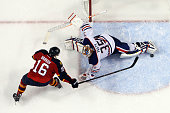 Goaltender Viktor Fasth of the Edmonton Oilers makes a save in the shootout against Aleksander Barkov of the Florida Panthers at the BBT Center on...