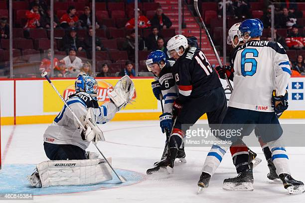 Goaltender Ville Husso of Team Finland makes a glove save with teammate Aleksi Makela defending against Sonny Milano of Team United States during the...