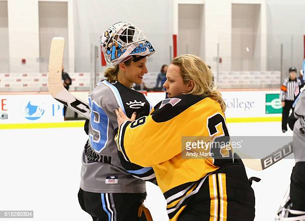 Goaltenders Brittany Ott of the Boston Pride Brianne McLaughlin of the Buffalo Beauts shake hands after the Pride defeated the Beauts 31 to win the...
