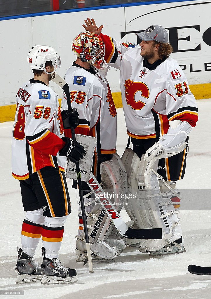 Goaltenders <a gi-track='captionPersonalityLinkClicked' href=/galleries/search?phrase=Joey+MacDonald&family=editorial&specificpeople=2234367 ng-click='$event.stopPropagation()'>Joey MacDonald</a> #35 and <a gi-track='captionPersonalityLinkClicked' href=/galleries/search?phrase=Karri+Ramo&family=editorial&specificpeople=716721 ng-click='$event.stopPropagation()'>Karri Ramo</a> #31 of the Calgary Flames celebrate with teammates a 2-1 win over the Florida Panthers at the BB&T Center on April 4, 2014 in Sunrise, Florida.
