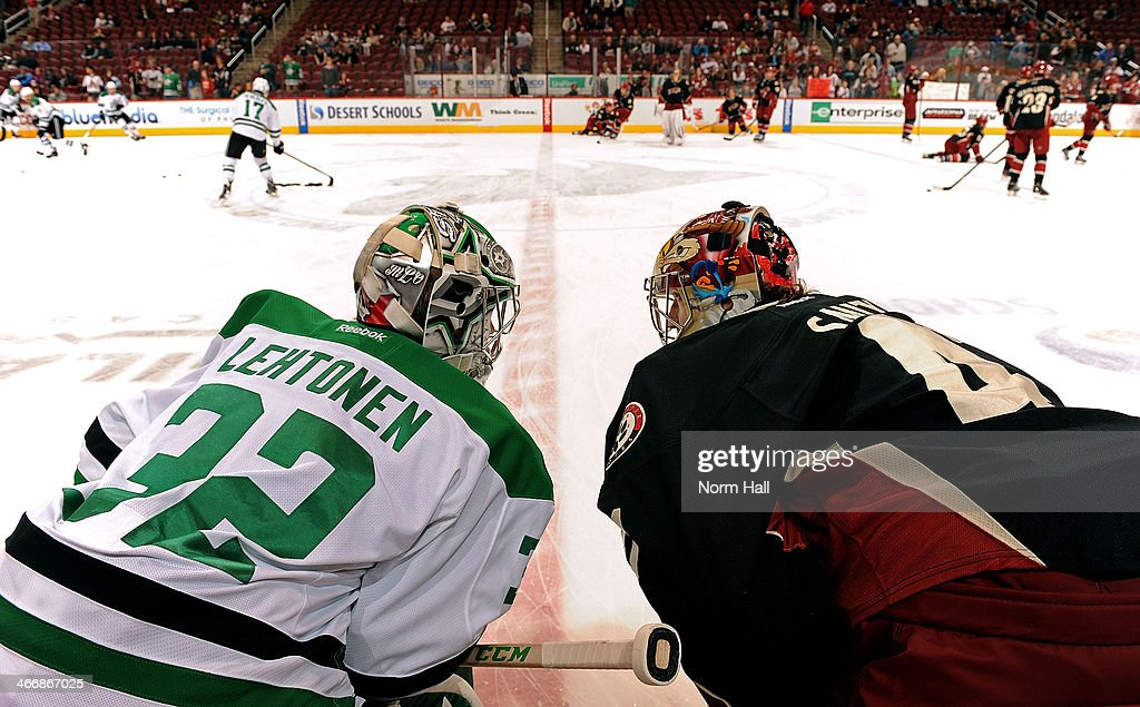 Goaltenders Kari Lehtonen #32 of the Dallas Stars and Mike Smith #41 of the Phoenix Coyoytes talk at center ice during the pre-game skate before the start of an NHL game at Jobing.com Arena on February 4, 2014 in Glendale, Arizona.