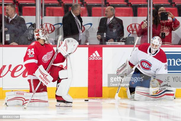 Goaltenders Petr Mrazek of the Detroit Red Wings and Antti Niemi of the Montreal Canadiens warmup along the boards prior to an NHL game at Little...