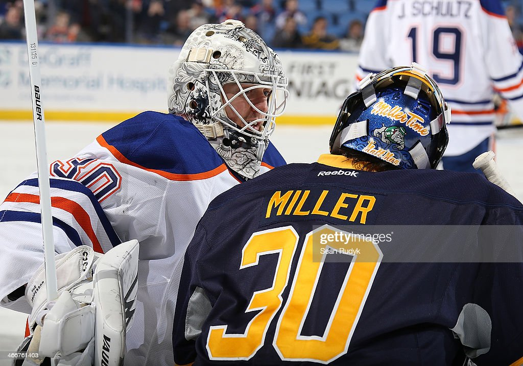 Goaltenders Ryan Miller #30 of the Buffalo Sabres and Ben Scrivens #30 of the Edmonton Oilers talk during warm-ups before a game at First Niagara Center on February 3, 2014 in Buffalo, New York.
