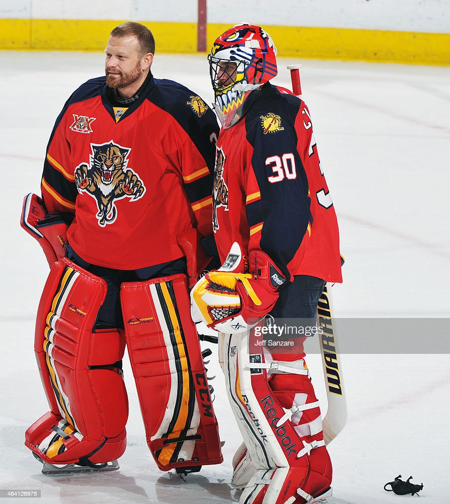 Goaltenders Scott Clemmensen and Tim Thomas of the Florida Panthers celebrate their win against the Montreal Canadiens at the BBT Center on December...