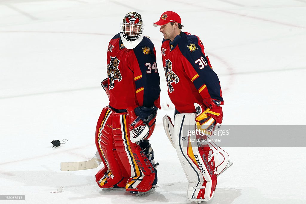 Goaltenders Tim Thomas and Scott Clemmensen of the Florida Panthers skate off the ice after their win against the New York Islanders at the BBT...