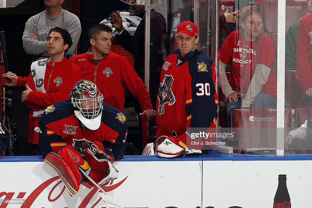 Goaltenders Tim Thomas and Scott Clemmensen of the Florida Panthers are on the bench while an extra attacker is in against the Detroit Redwings at...