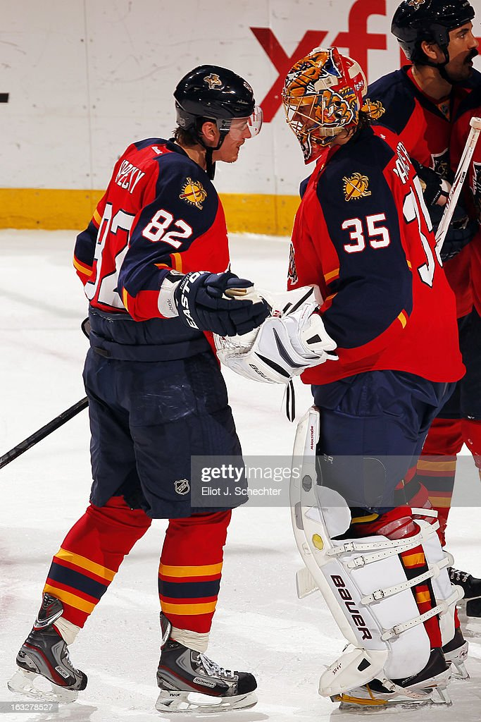 Goaltenter Jacob Markstrom #35 of the Florida Panthers celebrates their 4-1 win with teammate Tomas Kopecky #82 against the Winnipeg Jets at the BB&T Center on March 5, 2013 in Sunrise, Florida.