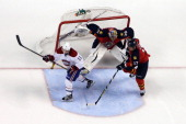 Goaltenter Jacob Markstrom of the Florida Panthers defends the net with the help of teammate Filip Kuba against Brendan Gallagher of the Montreal...