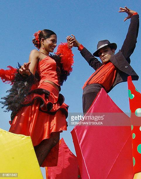 Goan dancers Jason and Sylvia get into the rhythm atop a float during a cultural parade at the inauguration of the 35th International Film Festival...