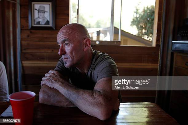 Goat Breker a former motocross championturned hotelier and desert offroad guide takes a lunch break at his Goat's Sky Ranch after a morning of...