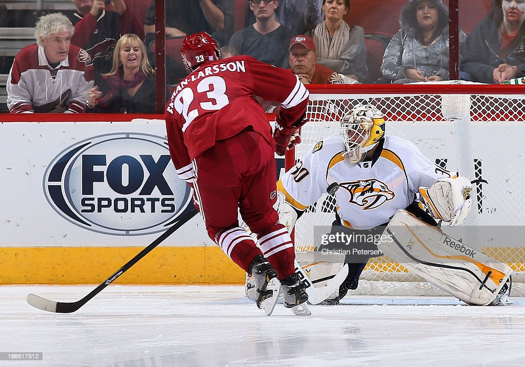 Goatlender <a gi-track='captionPersonalityLinkClicked' href=/galleries/search?phrase=Carter+Hutton&family=editorial&specificpeople=6872781 ng-click='$event.stopPropagation()'>Carter Hutton</a> #30 of the Nashville Predators makes a shoot out save on <a gi-track='captionPersonalityLinkClicked' href=/galleries/search?phrase=Oliver+Ekman-Larsson&family=editorial&specificpeople=5894618 ng-click='$event.stopPropagation()'>Oliver Ekman-Larsson</a> #23 of the Phoenix Coyotes during the NHL game at Jobing.com Arena on October 31, 2013 in Glendale, Arizona. The Coyotes defeated the Predators 5-4 in an overtime shoot out.