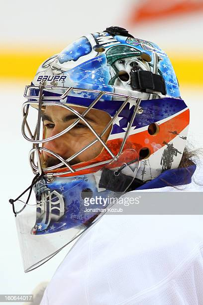Goatlender Rick DiPietro of the New York Islanders smiles as he takes a break during the pregame warm up prior to NHL action against the Winnipeg...