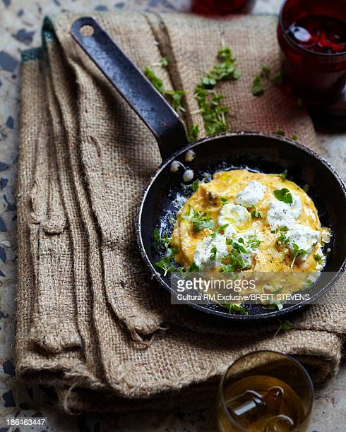 Goats cheese frittata in frying pan