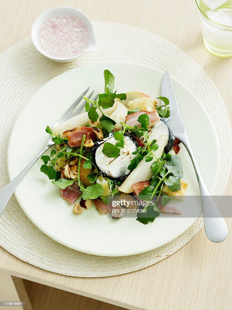 Goats Cheese, pear and hazelnut salad with bitter leaves : Stock Photo