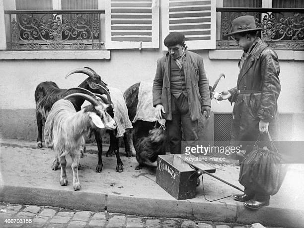 Goat's milk and cheese seller with customer in January 1929 in Paris France