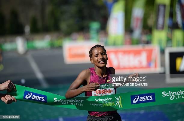 Gobena Amane of Ethiopia crosses the finish line in the 39th Paris Marathon in Paris on April 12 2015 Mark Korir of Kenya won the Paris Marathon his...