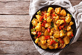 Indian Food: Gobi Aloo with cauliflower and vegetables close-up on a plate. horizontal top view