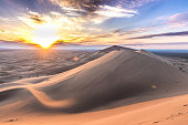 you can see strong sunset, impressive clouds and yellow sand. it is gobi desert in mongol.