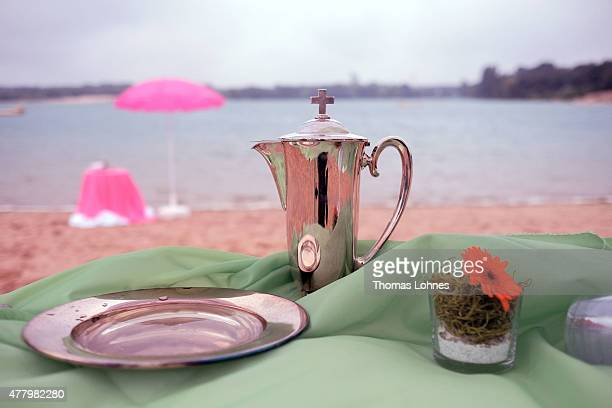 A goblet and a dish for the baptism stand at the lake 'Langener Waldsee' on June 21 2015 near Frankfurt am Main Germany Several protestant...