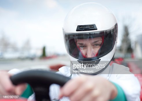 Go-cart driver looking at camera : Stock Photo