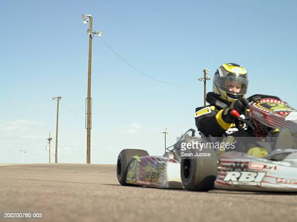 Go-cart racer on track (focus on background)