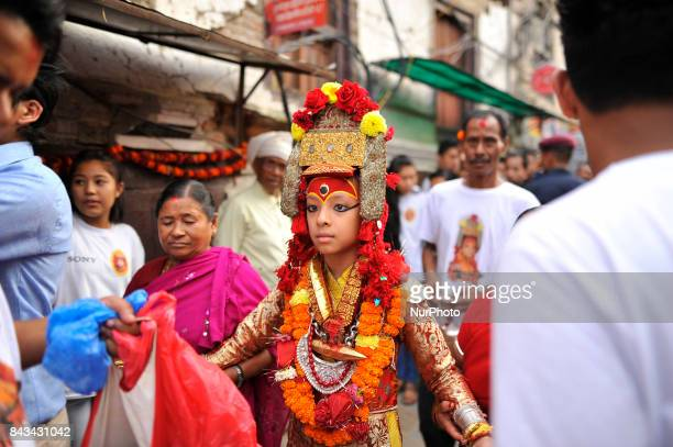 God 'Ganesh' walks towards chariot for the chariot pulling festival on the fourth day of Indra Jatra Festival celebrated at Basantapur Durbar Square...
