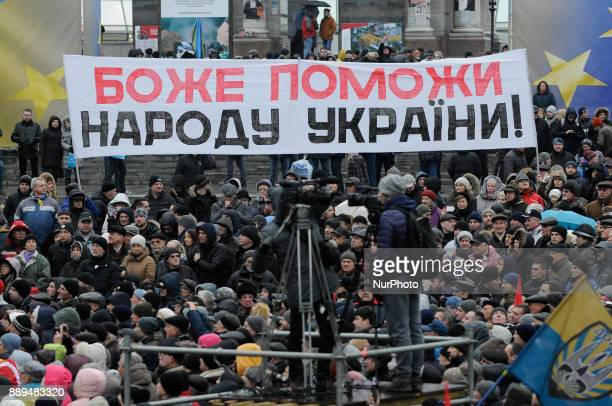 God help the counrty of Ukraine is seen on a banner during a really calling for the impeachment of president Petro Poroshenko in Kiev Ukraine on...