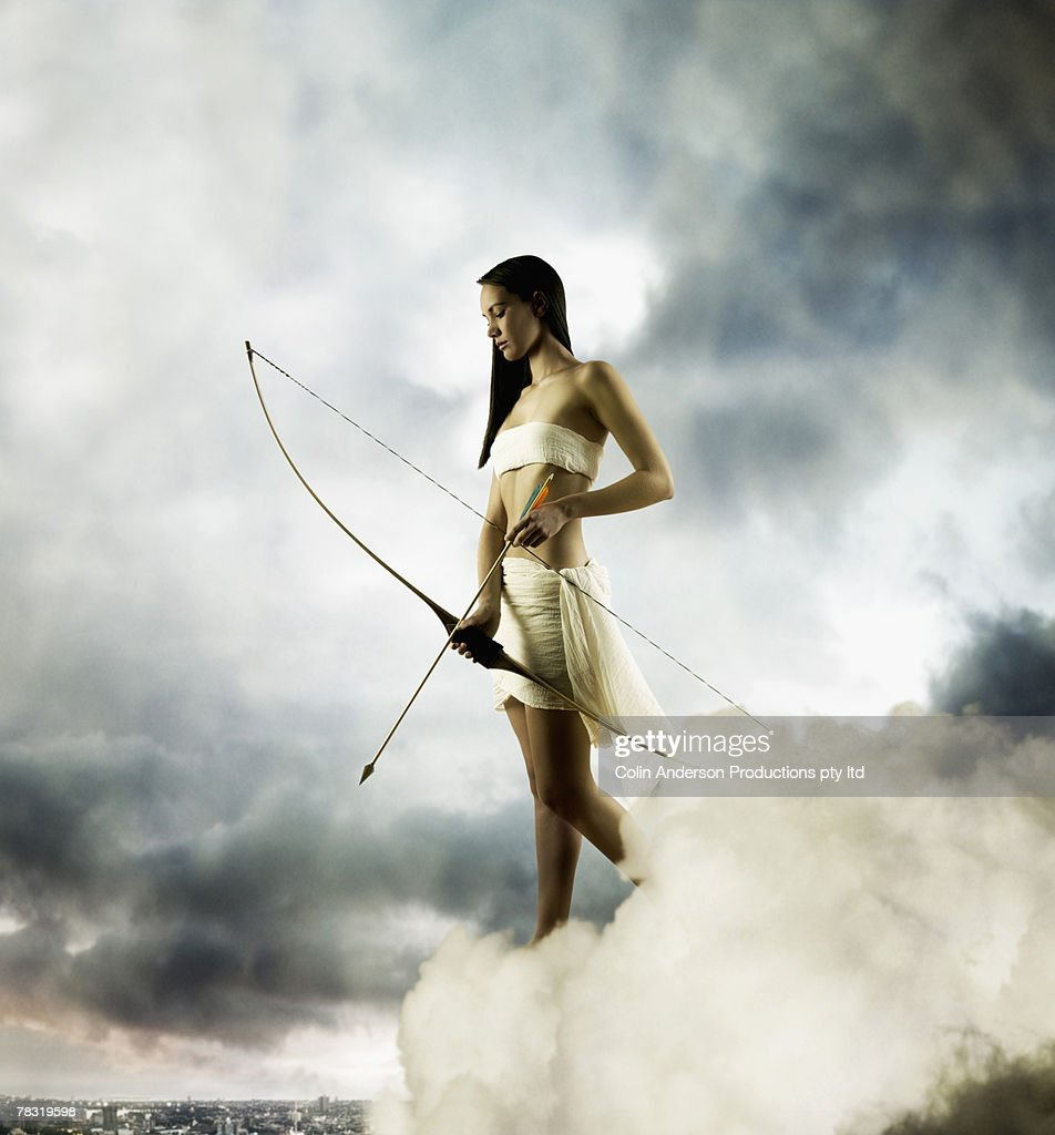 Goddess Diana with bow and arrow : Stock Photo