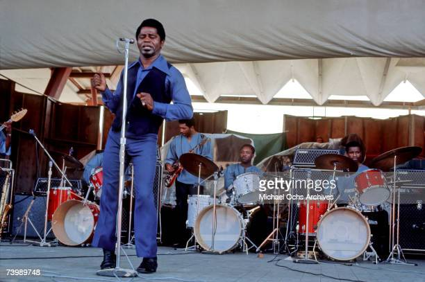 'Godfather of Soul' James Brown performs with 3 drummers at the Newport Folk Festival on July 6 1969 in Newport Rhode Island The license plate reads...